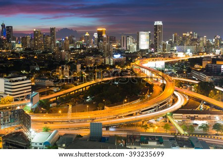Aerial view expressway interchanged with city downtown background night view
