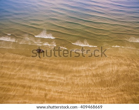 aerial view fisherman boat at beach with golden sand - stock photo