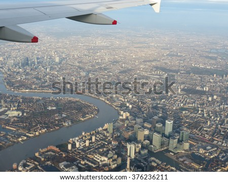 Aerial view from a flying plane in the sky over London city centre