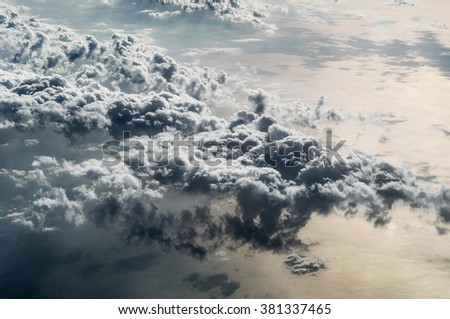 Aerial view from above beautiful fluffy clouds and the golden ocean as background image