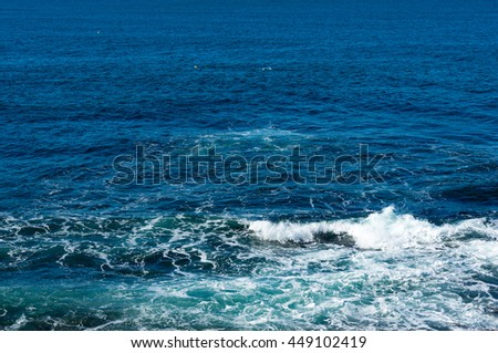 Aerial, view from above on an ocean water texture and moderate surf on a sunny day. Australia. Copy space