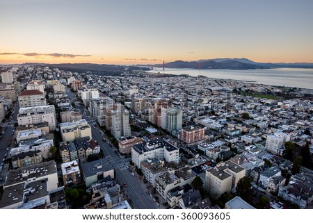 Aerial View from above San Francisco with the Bay Bridge, Presidio, and The Marin Headlands at sunset - stock photo