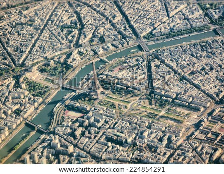 Aerial view from airplane of Paris with Eiffel Tower . - stock photo