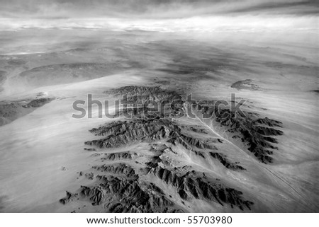 Aerial view from airplane window. Earth from above - stock photo