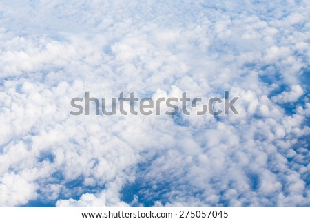 Aerial view from airplane with earth and clouds