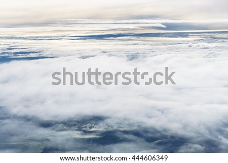 Aerial view from an airplane on a cloudy day. - stock photo