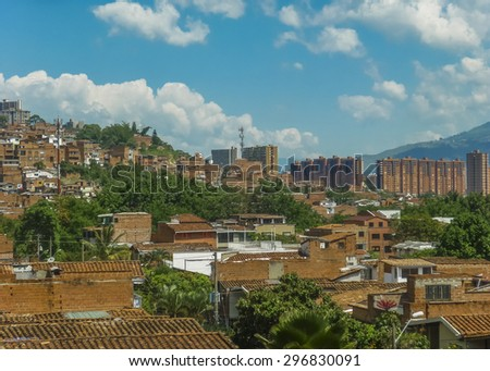 Aerial view from cableway of houses and mountains in a poor zone in the city of Medellin,one of the most important cities of Colombia. - stock photo