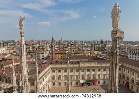 Aerial view from cathedral of Milan and it's intricate decorations over Milan, Italy - stock photo