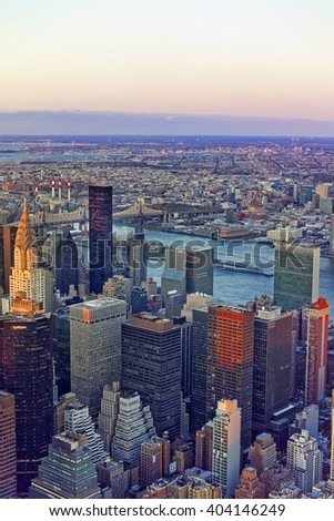 Aerial view from Observatory deck of the Empire State Building on Midtown district in Manhattan in New York. East river and New York Queensboro Bridge in Long Island City are on the background. - stock photo