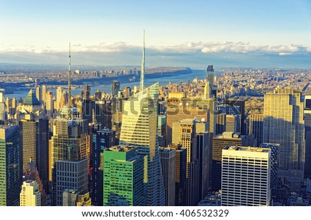 Aerial view from Observatory deck of the Empire State Building on Midtown Manhattan, New York, USA, at sunset. Hudson River and Jersey City, New Jersey, USA, on the background. - stock photo