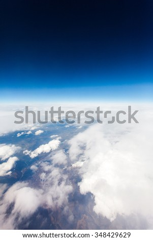 Aerial view from plane in mid flight, daytime over Europe - UK - stock photo