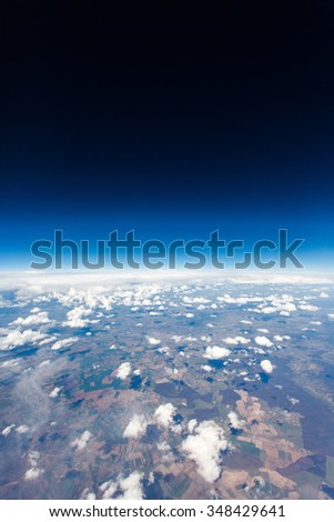 Aerial view from plane in mid flight, daytime over Europe - UK
