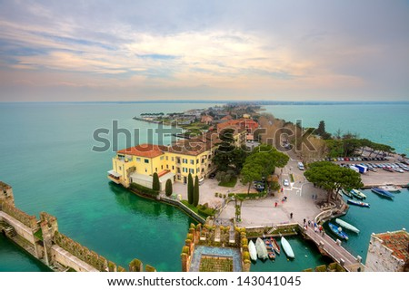 Aerial view from Scaglieri castle on Lake Garda and town of Sirmione in Italy. - stock photo