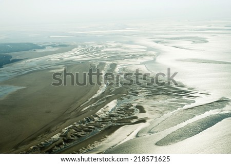 Aerial view from the Schleswig-Holstein Wadden Sea National Park in Germany - stock photo