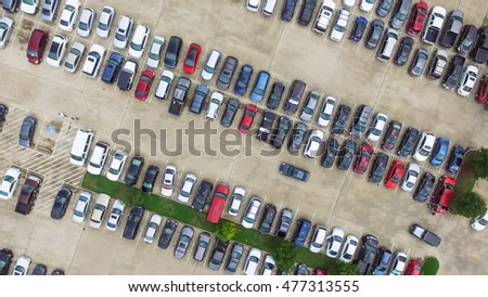 Aerial view full cars at large outdoor parking lots in Houston, Texas, USA. Outlet mall parking congestion and crowded parking lot, other cars try getting in and out, finding parking space. Panorama