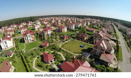 Aerial view gated development near forest at sunny summer day. - stock photo