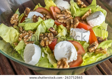 Aerial view healthy low carb salad with cheese tomatoes lettuce  Bowl with fresh green salad for lunch dinner snack. Vegetarian diet super-food for cook blog website magazin book cover blog business - stock photo
