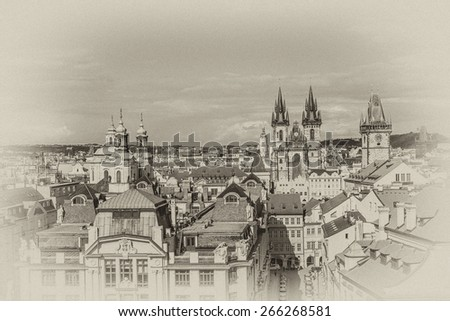 Aerial view: Houses with traditional red roofs in Prague. Prague (Praha) is capital, largest city of Czech Republic and historical capital of Bohemia. Prague situated on Vltava River. Antique vintage. - stock photo