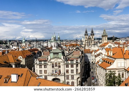 Aerial view: Houses with traditional red roofs in Prague. Prague (Praha) is capital, largest city of Czech Republic and historical capital of Bohemia. Prague situated on Vltava River.  - stock photo