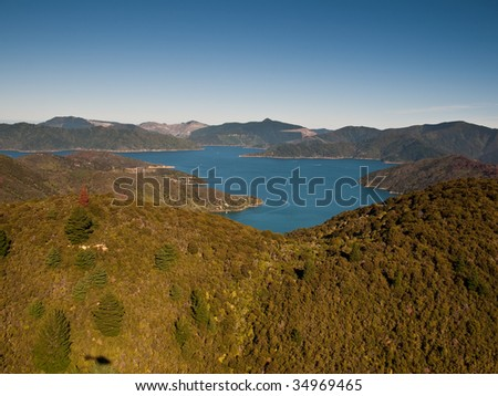 Aerial view looking over hill into Marlborough Sounds, New Zealand - stock photo