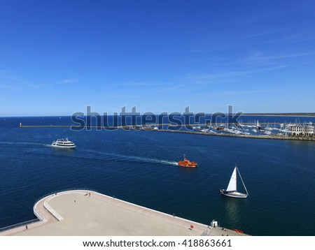 Aerial view marina entrance with blue water and sky