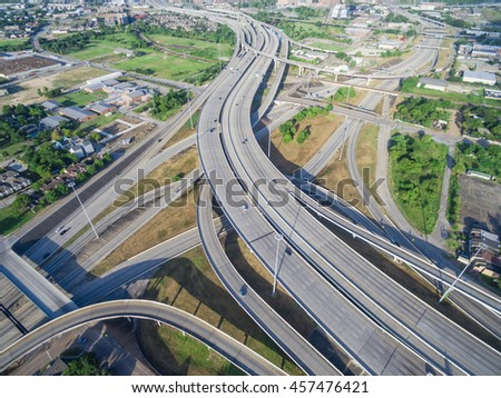 Aerial view massive interstate I69 highway intersection, stack interchange with elevated road junction overpass in downtown Houston. This five-level freeway interchange carry heavy rush hour traffic. - stock photo