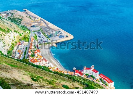 aerial view of a beach and adjacent residential houses in gibraltar - stock photo