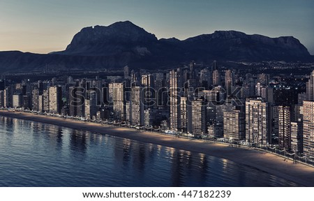 Aerial view of a Benidorm city coastline at sunset. Benidorm is a modern resort city, one of the most popular travel destinations in Spain. Costa Blanca, Alicante province - stock photo