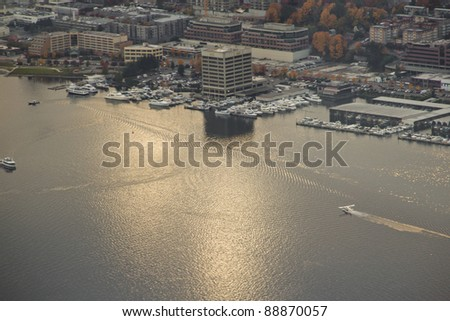 Aerial view of a chartered seaplane landing at Lake Union in Seattle, WA - stock photo