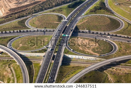 Aerial view of a classic cloverleaf transport intersection  - stock photo