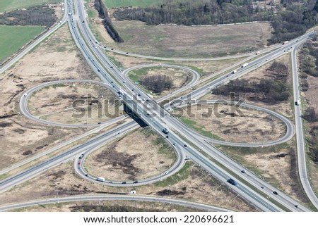 "Aerial view of a ""clover"" transport intersection at Kievskoe highway in Russia. - stock photo"