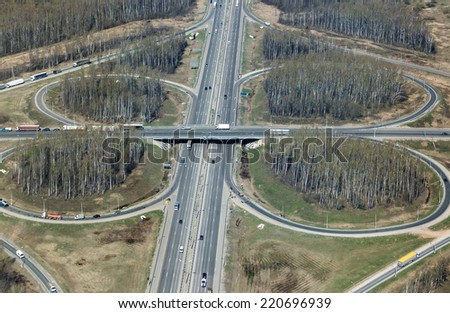Aerial view of a cloverleaf road intersection near Moscow in Russia - stock photo
