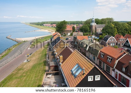 Aerial view of a Dutch fishing village seen from the Lighthouse - stock photo