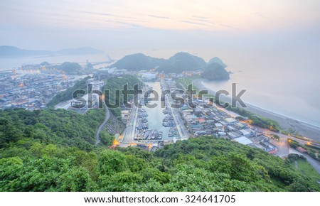 Aerial view of a fishing village at dawn on northern coast of Taipei Taiwan ~ Aerial view of a harbor in the foggy morning in northern Taiwan - stock photo