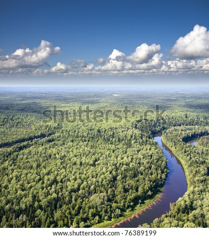 Aerial view of a forest river. - stock photo