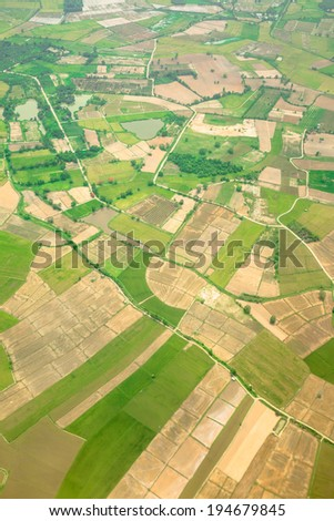 Aerial view of a green rural area  - stock photo