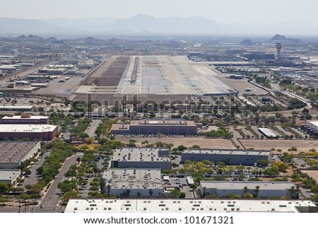 Aerial view of a jet airliner landing at a large metropolitan airport - stock photo