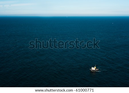 Aerial view of a lonely boat in the ocean