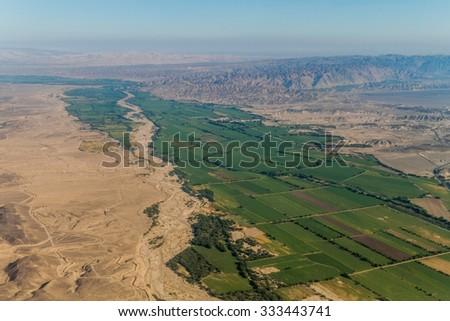 Aerial view of a lush green valley near Nazca, Peru - stock photo