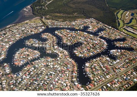 Aerial view of a luxury housing estate in Queensland showing colorful roof tops - stock photo