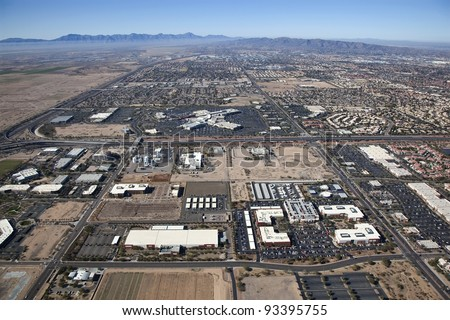 Aerial view of a mix of Industrial, Retail and Residential in the desert southwest - stock photo