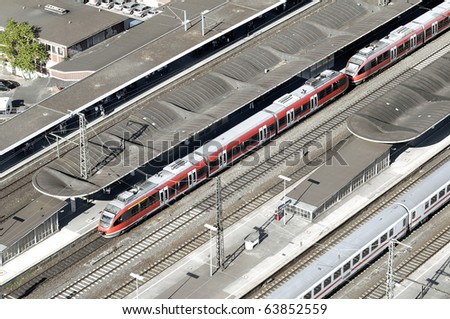 Aerial view of a modern railway station with speed trains waiting for passengers. Useful file for your travel, technical and other need brochure.