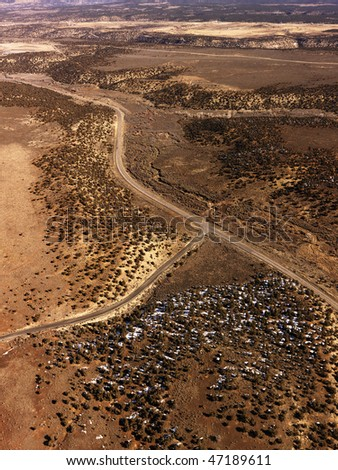 Aerial view of a of rural, desert landscape with roads running through it. Vertical shot. - stock photo