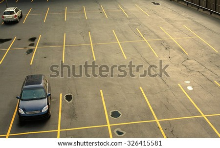 Aerial view of a parking lot with cars - stock photo