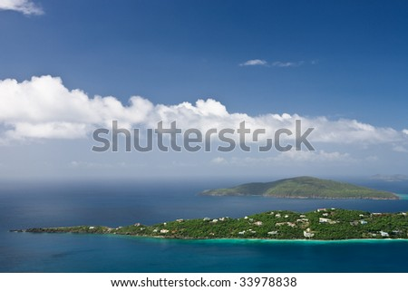 Aerial view of a peninsula and Hans Lollik Islands off the coast of St. Thomas - stock photo