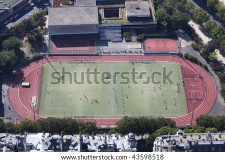 Aerial view of a practice field, with kids playing football (soccer)