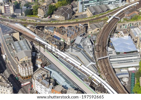 Aerial view of a railway triangle with trains in London, UK.