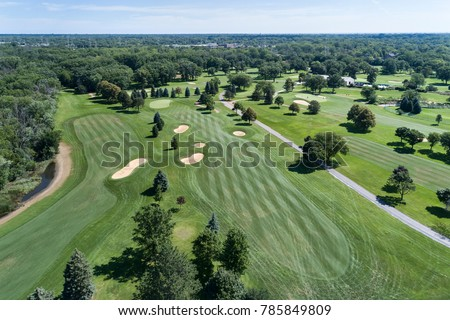Aerial view of a suburban Chicago golf course with fairways and sand traps in Wilmette, IL. USA