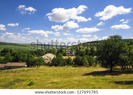 Aerial view of a summer rural area under blue sky. Curchi monastery before reconstruction, Moldova - stock photo