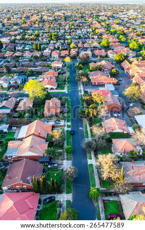 Aerial view of a typical Melbourne suburban street in the warm glow of a spring sunrise. - stock photo